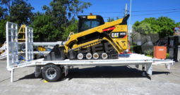 #2302T Caterpillar 297D XPS + 9 Ton Trailer